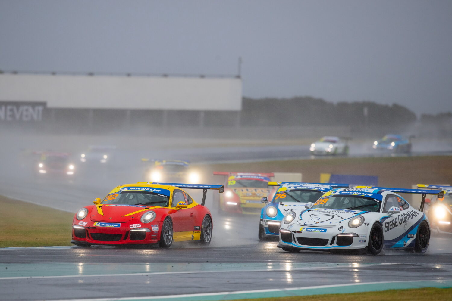 Courtney Prince and  Bayley Hall racing in wet conditions at Phillip Island. Porsche Michelin Sprint Challenge at Phillip Island, March 2021.