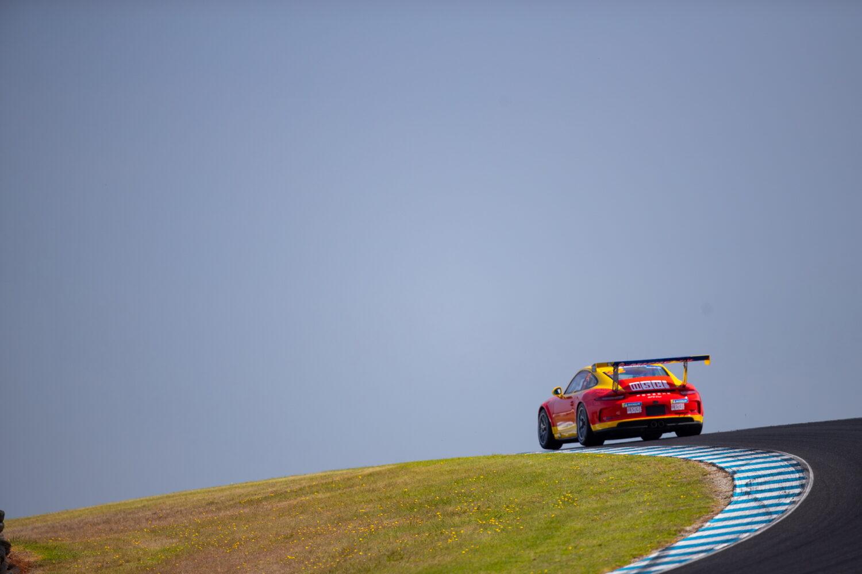Courtney cornering on a high peak. Porsche Michelin Sprint Challenge at Phillip Island, March 2021.