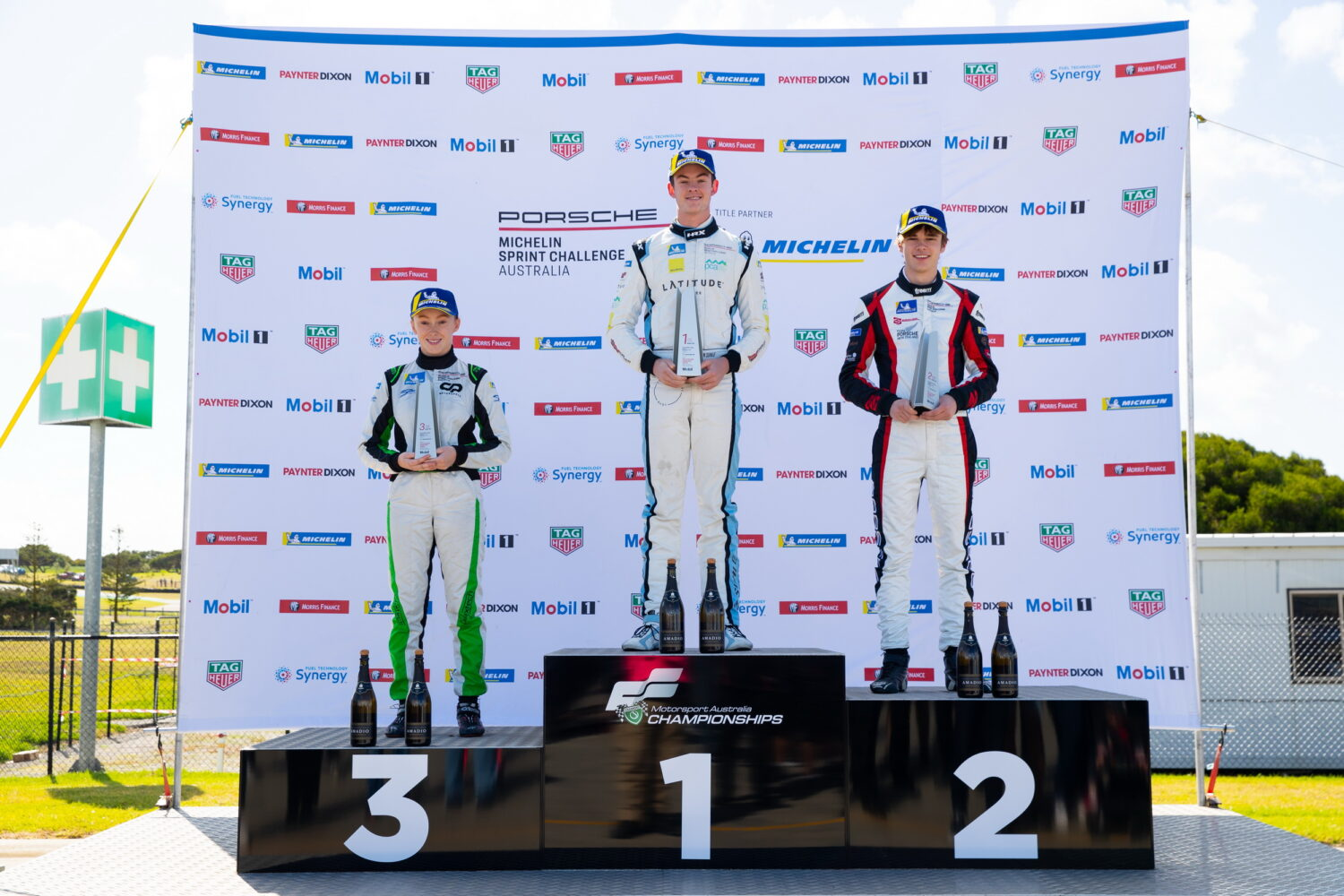 Winning drivers on the podium, with Courtney in third position. Porsche Michelin Sprint Challenge at Phillip Island, March 2021.